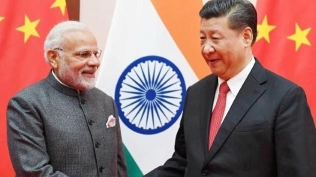 India's Prime Minister Narendra Modi shakes hands with Chinese President Xi Jinping during the 18th Shanghai Cooperation Organisation (SCO) Summit in Qingdao, China, June 9, 2018.(Reuters file photo)