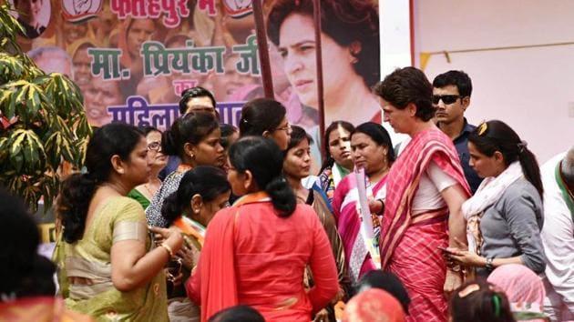Congress General Secretary Priyanka Gandhi Vadra talks to the women supporters during the 'Mahila Samvad' program meet Aung in Fatehpur on Saturday.(ANI)