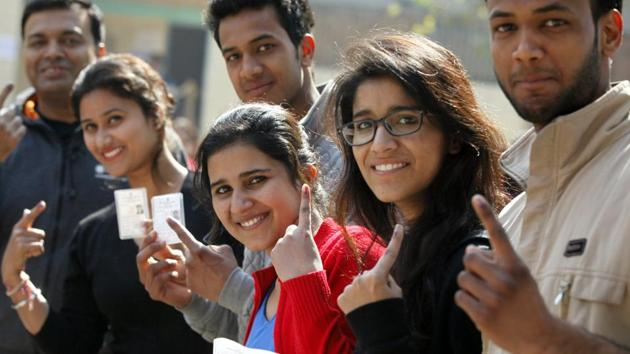 New Delhi, India - Feb. 7, 2015: Young Voters who are voting for the first time, showing their inked fingers after casting their votes for Delhi Assembly Elections, at South Delhi in New Delhi, India, on Saturday, February 7, 2015. (Photo by Raj K Raj/ Hindustan Times)(Hindustan Times)
