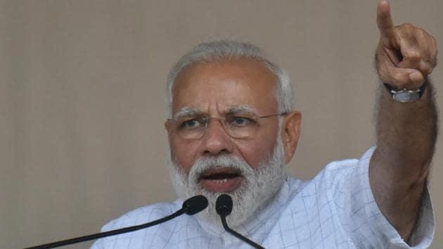 Prime Minister Narendra Modi addressing a public rally.(HT Photo/Samir Jana)