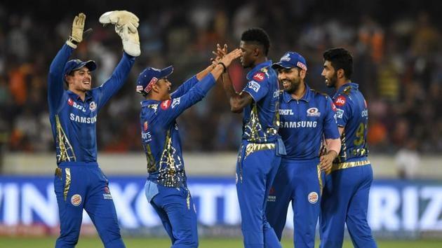 Mumbai Indians cricketer Alzarri Joseph (C) celebrates with his teammates for the wicket of Sunrisers Hyderabad Rashid Khan (unseen) during the 2019 Indian Premier League (IPL) Twenty20 cricket match between Sunrisers Hyderabad and Mumbai Indians(AFP)