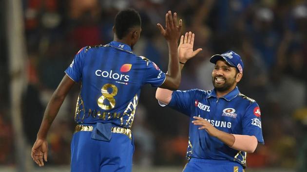 Mumbai Indians (MI) captain Rohit Sharma greets bowler Alzari Joseph(PTI)