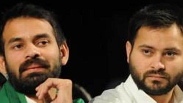 RJD leader Tejashwi Yadav (right) alleged a conspiracy against his father Lalu Prasad and is angry that he has not been allowed to meet him in hospital.(HT File Photo)