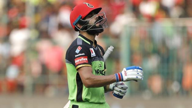 Royal Challengers Bangalore captain Virat Kohli reacts as he leaves the field after being dismissed.(AP)