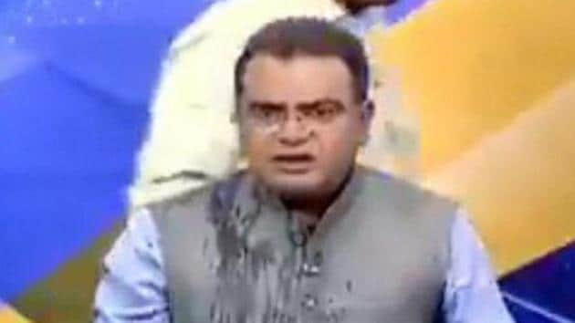 Congress leader throws water at BJP counterpart on live TV for calling him traitor(ANI Photo)