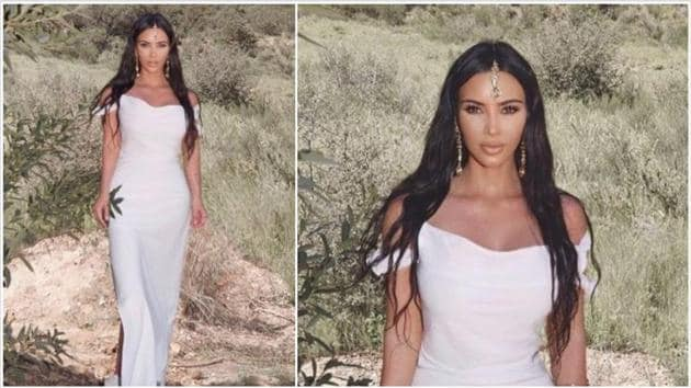 Kim Kardashian in a white dress paired with a maang tikka.