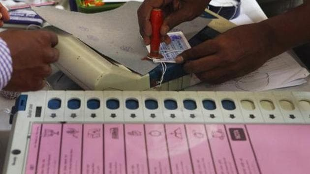 Mumbai, India - Oct. 8, 2014 : Election Commission staff seals the Electronic Voting Machines (EVMs) at 181 Mahim Assembly (Vidhan Sabha) Constituency election office in D'Silva School, Dadar, Mumbai, India on Wednesday, October 8, 2014, days ahead of the upcoming ASSEMBLY (VIDHAN SABHA) ELECTIONS on October 15, 2014. (Photo by Kalpak Pathak / Hindustan Times)(Hindustan Times)
