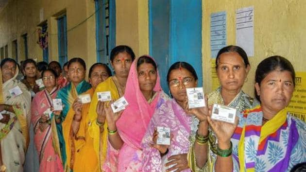 Karad: Voters show their identity cards as they stand in a queue at a polling station to cast their vote for the Gram Panchayat elections at Masur village, in Karad, Sunday, Feb. 24, 2019. (PTI Photo)(PTI2_24_2019_000044B)(PTI)