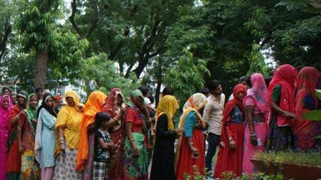 Rajasthan, India – August 17, 2015: Women voters wait to cast their votes during Municipal Corporation polls at a polling booth of Chomu, in Jaipur, Rajasthan, India on Monday, August 17, 2015.(Prabhakar Sharma/ Hindustan Times)
