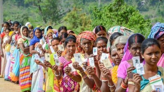Silli: Voters show their identity cards as they wait in a queue to cast their votes for Silli Assembly bypolls, at a polling station, in Silli on Monday. PTI Photo (PTI5_28_2018_000179B)(PTI)
