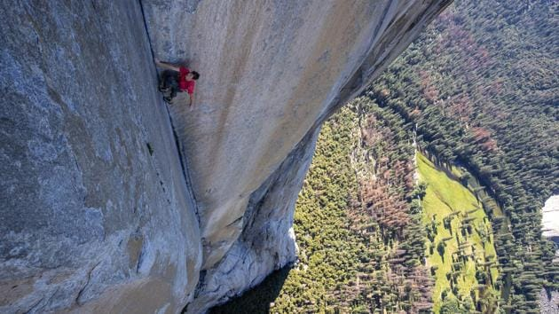Free solo is when you climb a rock with no ropes and no gear - just shoes and a bag of chalk. Here, Alex Honnold is in the process of making history as he free solos up the 3,200-ft-high El Capitan in California's Yosemite National Park.
