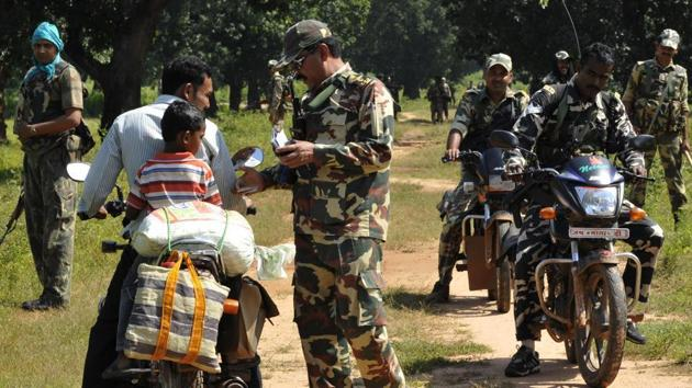 Around 80,000 state and paramilitary personnel were deployed in the Bastar region for peaceful polling in view of a boycott call by Maoists.(HT Photo)