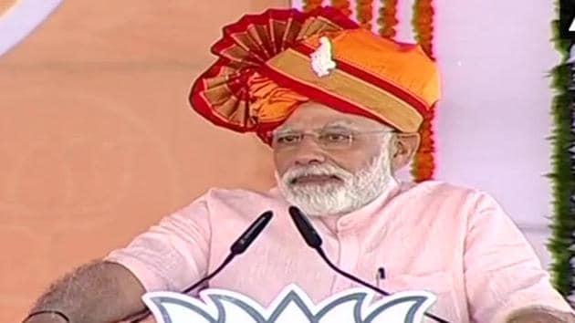Prime Minister Narendra Modi addressing an election rally at Ahmedanagar in Maharashtra on Friday.(ANI)