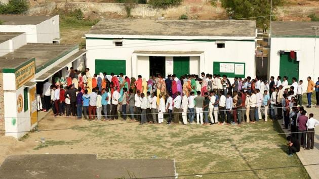 Greater Noida, India - April 11, 2019: People stand in queues to cast their votes during the first phase of the Lok Sabha elections, at Atta Gujjran in Greater Noida, India, on Thursday, April 11, 2019. (Photo by Virendra Singh Gosain/ Hindustan Times) **To go with Preety's story.(Virendra Singh Gosain/HT PHOTO)