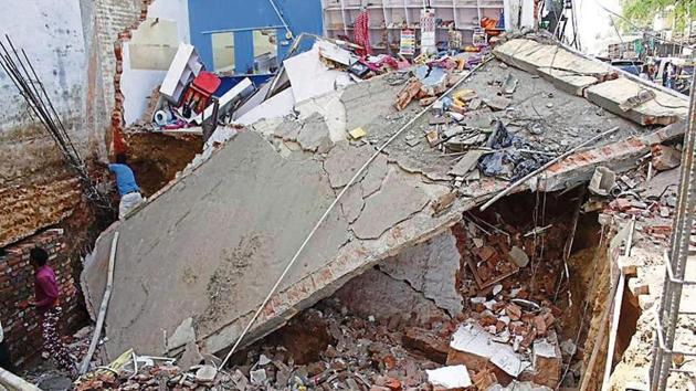 The one-storey building in Sector 13 is located in the 900-metre radius of IAF ammunition depot, where no new construction is allowed as per a Sept 2016 Punjab and Haryana HC order.(Yogendra Kumar/HT)
