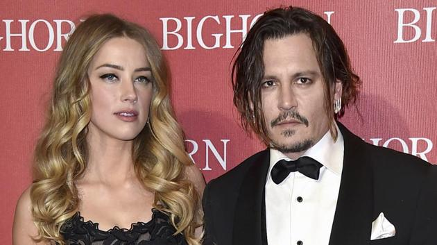 Amber Heard, left, and Johnny Depp arrive at the 27th annual Palm Springs International Film Festival Awards.(Jordan Strauss/Invision/AP)