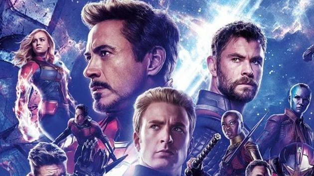 Robert Downey Jr, Chris Evans and others on an Avengers: Endgame banner.