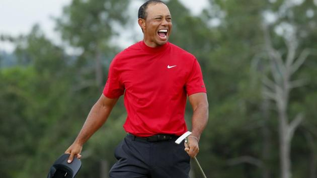 Tiger Woods of the U.S. celebrates on the 18th hole after winning the 2019 Masters.(REUTERS)