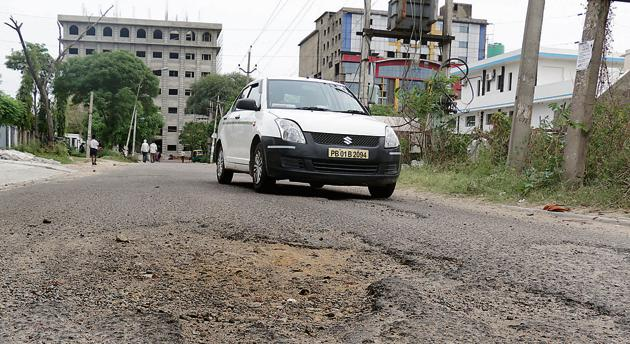 Residents of New Palam Vihar have asked the authorities to fix the road between Rezangla Chowk and Chauma railway crossing, which is riddled with potholes, ahead of monsoon.