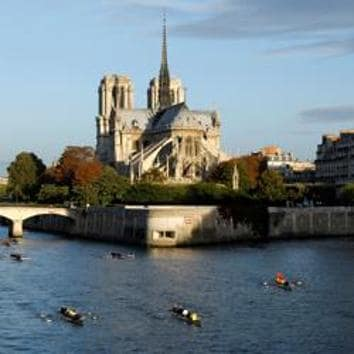 FILE PHOTO: Rowers pass Notre Dame Cathedral on their boats in Paris, September 26, 2010. REUTERS/Benoit Tessier/File Photo(REUTERS)