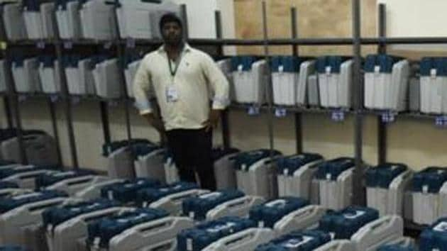 Bengaluru, India - May 11, 2018: Polling staffs checking the Electronic Voting Machines inside the strong room before distributing them at the Mustering centre in Kamlabai Girls High School in Bengaluru, India, on Friday, May 11, 2018. Karnataka state Assembly election will be held on 12th May in 223 seats out of 224. (Photo by Arijit Sen/Hindustan Times)(Arijit Sen/HT Photo)
