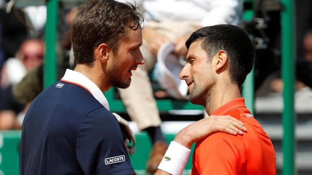 Russia's Daniil Medvedev with Serbia's Novak Djokovic after winning their quarter final match.(REUTERS)