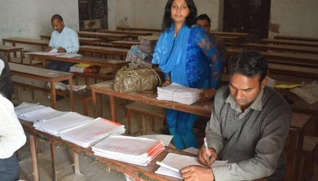 Teachers evaluating answer sheets at an evaluation centre in Prayagraj last month.(HT File)