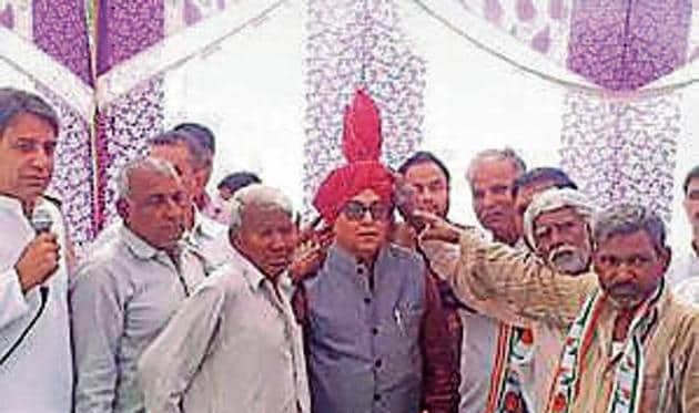 """Interacting with the villagers, Yadav said that the time has come to defeat the communal and divisive forces. """"The BJP has failed to create jobs; it has destroyed the economy through demonetisation and the hasty implementation of Goods and Services Tax(GST),"""" he said.(HT PHOTO)"""