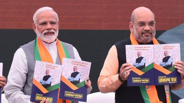 Modi finds mention at least 26 times and features prominently on the cover.(Arvind Yadav/HT PHOTO)