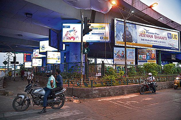 The hoardings block traffic signs and signals and could be a safety hazard for motorists, said police.(HT file)