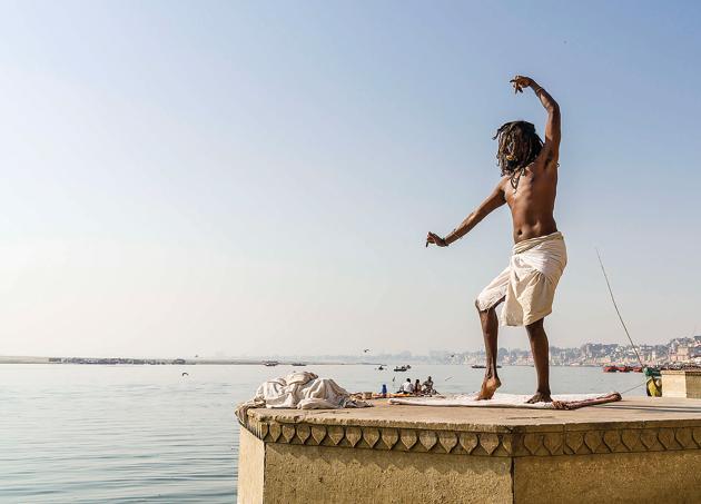 A sadhu dancing on a platform at Meer Ghat in Varanasi.(LightRocket via Getty Images)