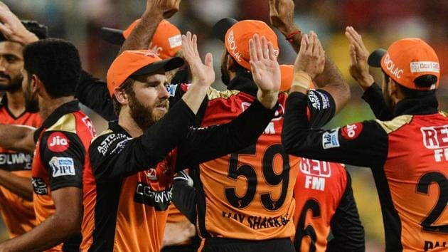 Sunrisers Hyderabad players celebrate after the fall of wicket.(AFP)