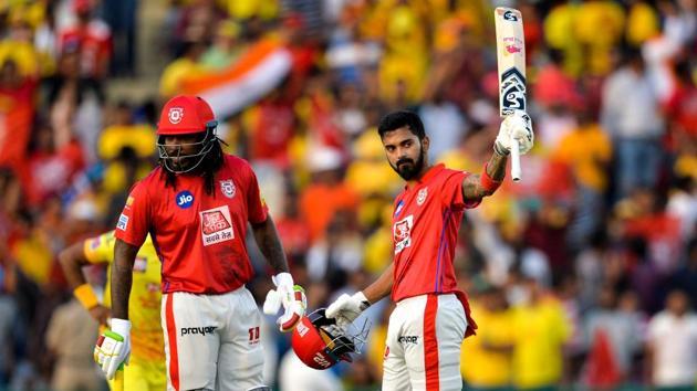 Kings XI Punjab cricketer KL Rahul (R) raises his bat after he scoring his fifty.(AFP)