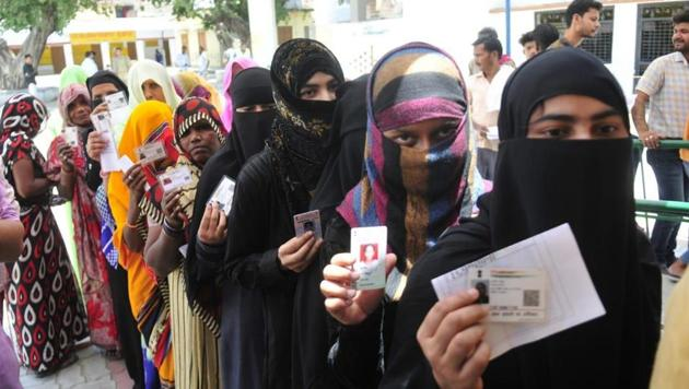 Female voters displaying their inked finger after casting vote during 5th phase of Lok sabha electionhere at Mujasa village Malihabad in Lucknow.(Deepak Guptaj/HT Photo)