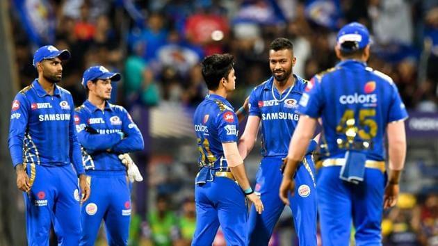 Mumbai Indians bowler Hardik Pandya (2R) celebrates with teammates after taking the wicket of Kolkata Knight Riders batsman Shubman Gill during the 2019 Indian Premier League (IPL)(AFP)