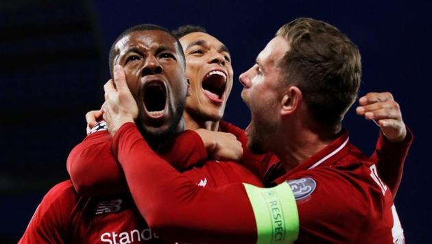 Liverpool's Georginio Wijnaldum celebrates scoring their third goal with Jordan Henderson and Trent Alexander-Arnold(REUTERS)