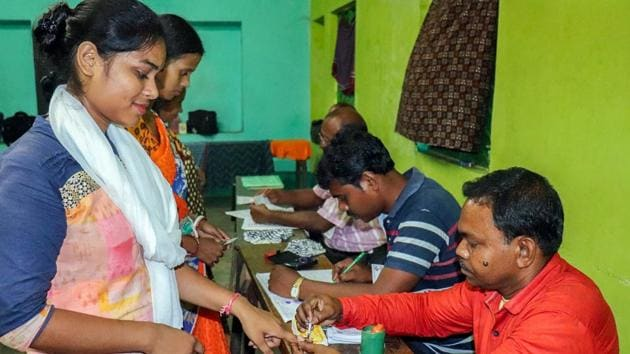 A voter gets her finger marked with indelible ink before casting her vote at a polling station in Madhya Pradesh.(PTI photo)