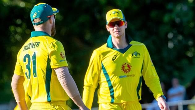 Australia's Steve Smith (R) and Australia's David Warner speak during the second of three warm-up cricket matches between New Zealand and Australia in Brisbane on May 8, 2019(AFP)