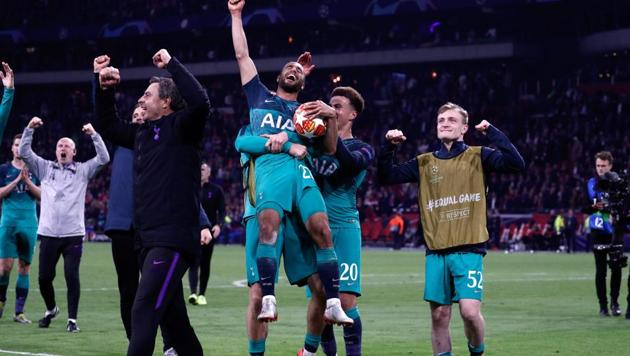 Tottenham's Brazilian forward Lucas (C) celebrates the victory with teammates at the end of the UEFA Champions League semi-final second leg football match between Ajax Amsterdam and Tottenham Hotspur at the Johan Cruyff Arena, in Amsterdam, on May 8, 2019. -(AFP)