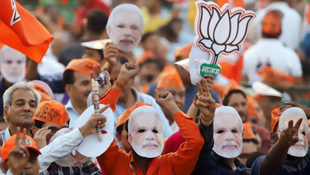 Supporters of the Bharatiya Janata Party (BJP) wear masks in the likeness PM Modi during a rally in New Delhi, on Wednesday, May 8, 2019.(Bloomberg)