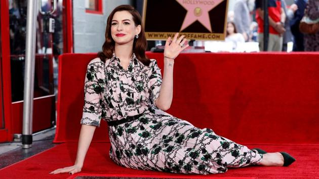 Anne Hathaway poses as she is honoured with a star on the Hollywood Walk of Fame in Los Angeles.(REUTERS)