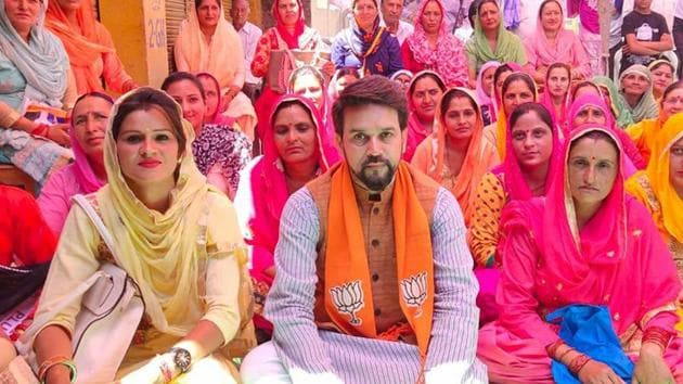 BJP sitting MP and candidate from Himachal Pradesh's Hamirpur Anurag Thakur during his election campaign in constituency.(HT file photo)