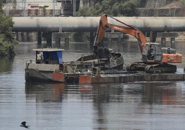 Desilting work was undertaken at the Mithi river near Mahim last week.(HT file)
