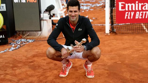 Serbia's Novak Djokovic celebrates with the trophy after winning the final against Greece's Stefanos Tsitsipas.(REUTERS)