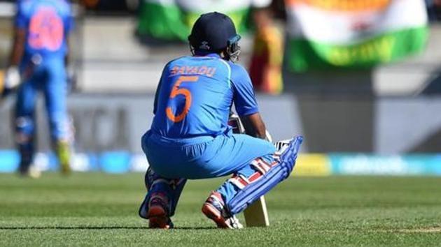 India's Ambati Rayudu (C) reacts as teammate Vijay Shankar (back L) walks from the pitch.(AFP)