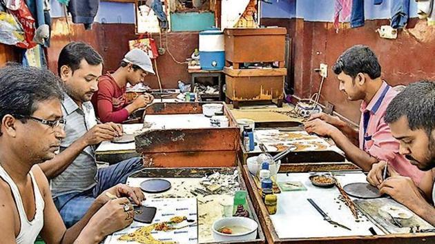 Artisans at work at a small unit that handles gold and silver ornamental work in Regar Pura in Karol Bagh, in New Delhi(Raj K Raj/ Hindustan Times)