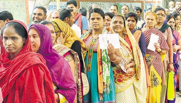 Female voters in a long queue wait outside a polling booth to cast their vote for sixth phase of Lok Sabha elections in Bhopal on April 12.(ANI)