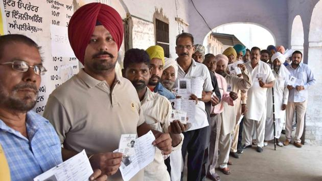 Ludhiana, India – May 19, 2019 : Voters standing in a queue to cast their votes at a polling booth at village Lalton in Ludhiana on Sunday, May 19, 2019. (Photo by Gurminder Singh/Hindustan Times)