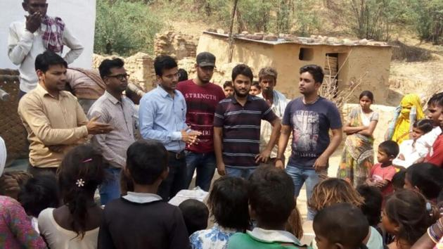 Medical student Ashwani Parashar with friends from SMS Medical College at Rajghat village in Dholpur.(HT Photo)