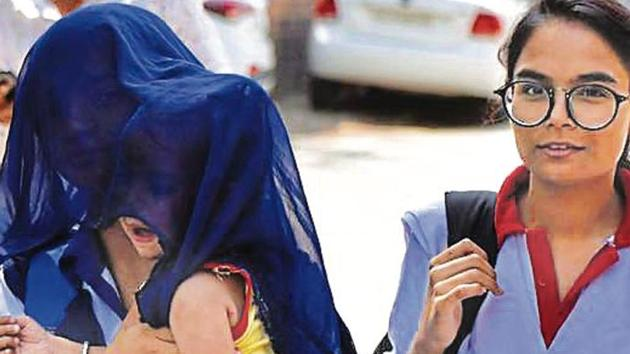 A woman shields her child from the sun on Monday, when the day temperature soared in Gurugram(Yogesh Kumar /HT)